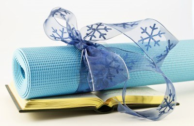 9397585-serene-blue-yoga-mat-wrapped-with-blue-ribbon-placed-with-open-book-fitness-study-and-yoga-are-gifts